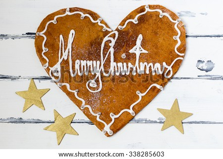 gingerbread heart with wishful greeting - stock photo