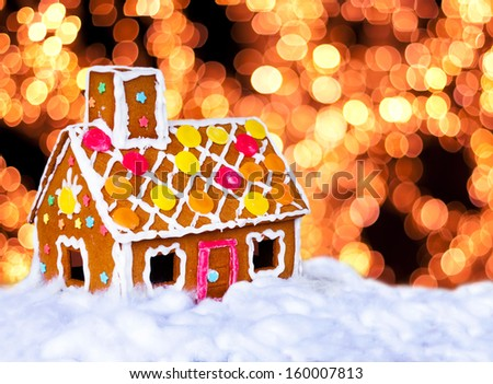 Gingerbread house and Christmas lights - stock photo