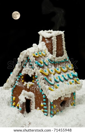 Gingerbread house at night with moon on sky - stock photo