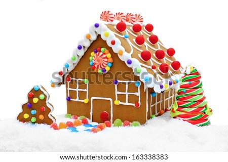 Gingerbread house in snow isolated on a white background - stock photo