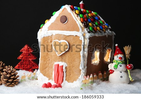 Gingerbread house on black background - stock photo