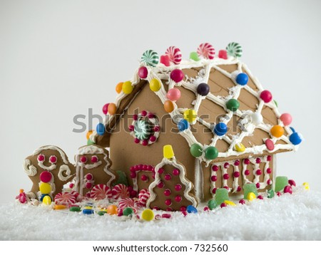 Gingerbread House on snow - stock photo