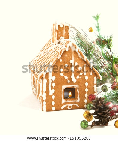 Gingerbread house with Christmas decoration isolated on white background - stock photo