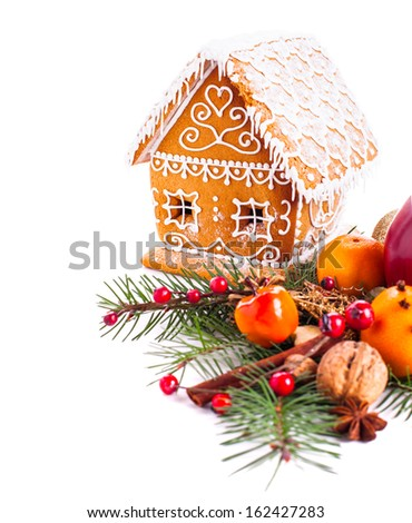 gingerbread house with christmas decorations on a white backgrond - stock photo