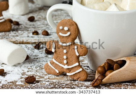 Gingerbread man and a cup of coffee with marshmallow close up - stock photo