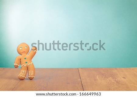 Gingerbread Man conceptual photo for Christmas card background - stock photo