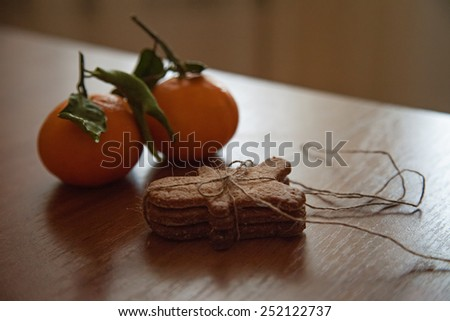 Gingerbread man cookie on wooden table - stock photo