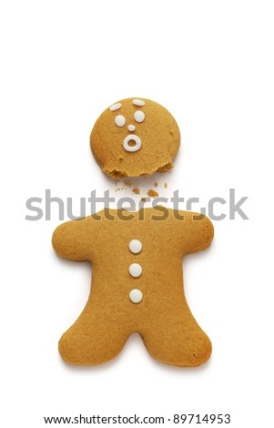Gingerbread man loses his head - stock photo
