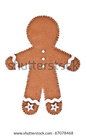 gingerbread man made of felt on the white background - stock photo