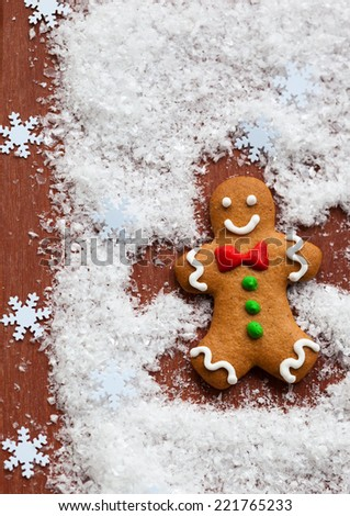 Gingerbread Man Snow Angel - stock photo