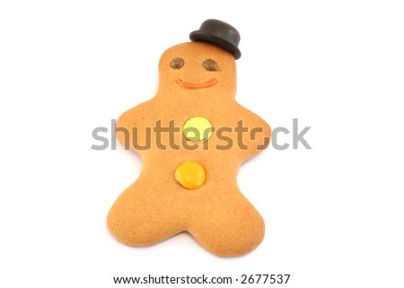 Gingerbread man with a bowler hat set at a jaunty angle. Focus is on face and hat - stock photo