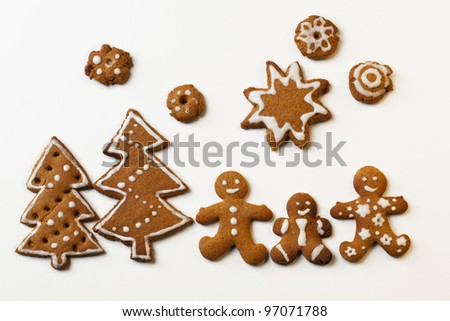 Gingerbread Men with Star and Christmas trees - stock photo