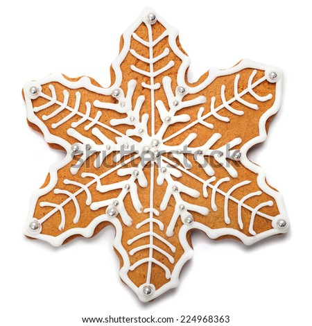 Gingerbread snowflake over white background - stock photo
