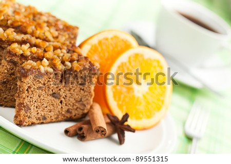 Gingerbread with orange and cup of coffee or tea. - stock photo