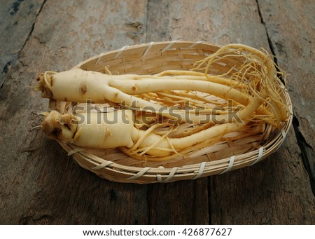 Ginseng on wood background.Korean ginseng on bamboo weave. - stock photo