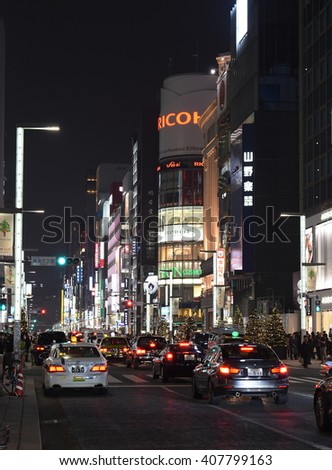 GINZA, JAPAN - DECEMBER 10 : Ginza crossroad at night taken December 10, 2015 in Tokyo. Landmark of Ginza shopping area. The popular tourist spot in Tokyo. - stock photo