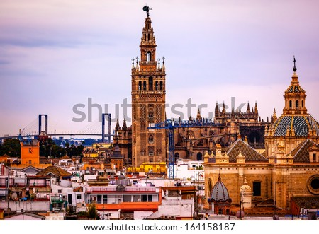 Giralda Spire Bell Tower Seville Cathedral Church of El Salvador Seville, Andalusia Spain.  Giralda is largest Gothic Cathedral in the World and burial Place of Christopher Columbus.   - stock photo