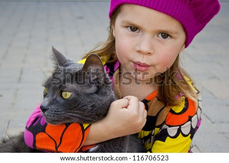 Girl and a gray cat - stock photo