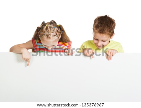 girl and boy beside a white blank - stock photo