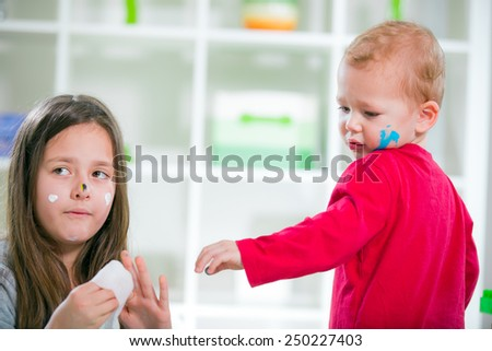Girl and boy dirty and paint - stock photo
