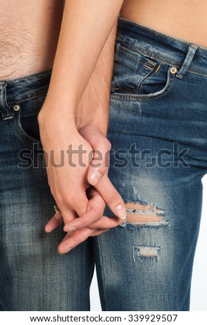 Girl and boy holding hands. Closeup of young affectionate couple holding hands - stock photo