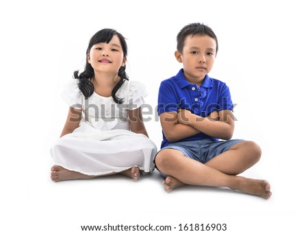 girl and boy sitting together - stock photo
