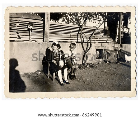 girl and boy, slovakia about 1940 - stock photo