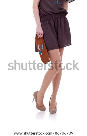 Girl and brown Bag, over white background - stock photo