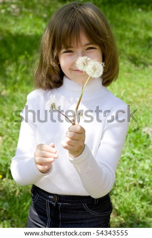 Girl and dandelions - stock photo