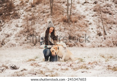 Girl and dog having a good time together - stock photo