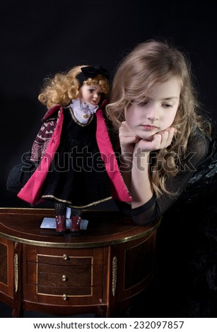 Girl and doll - stock photo