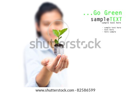Girl and green tree light bulbs, Symbol of go green concept - stock photo