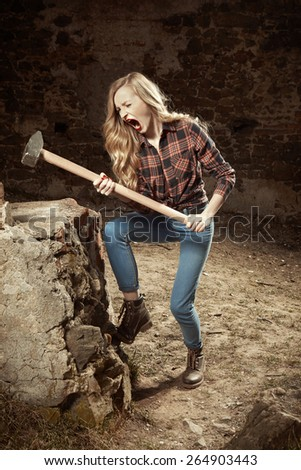 Girl and hammer - stock photo
