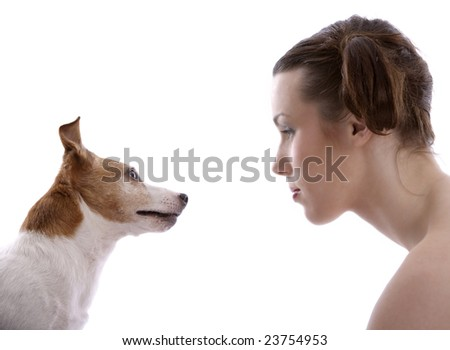 Girl and her dog looking at eachother - stock photo