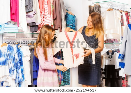 Girl and her mother shopping together in the store - stock photo