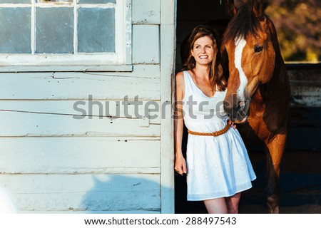 Girl and Horse - stock photo