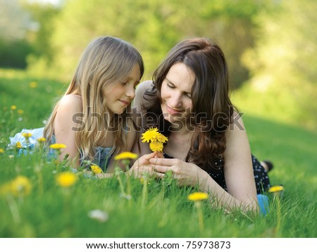 Girl and mother in the park - stock photo