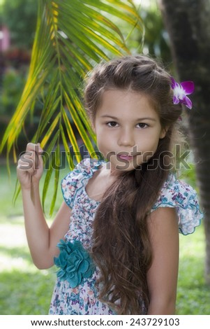Girl and palm tree - stock photo