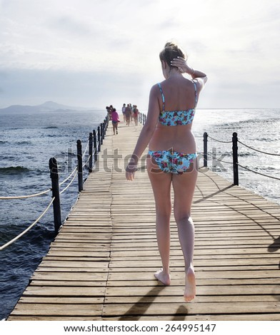 Girl and sea. - stock photo