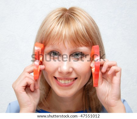 Girl and sweet pepper - stock photo