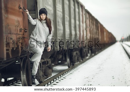Girl and wagon part. Girl and train - stock photo