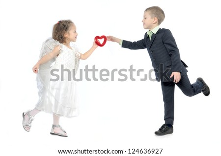 girl angel gives the boy's heart - stock photo