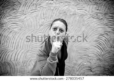 Girl angry silence in urban street violence - stock photo