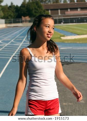Girl at school stadium - stock photo