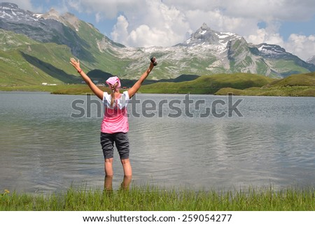 Girl at the mountain lake, Switzerland - stock photo