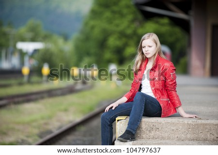 Girl at the station - stock photo