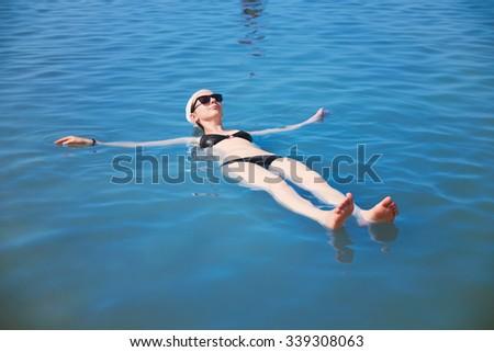 girl bathing in the Dead Sea - stock photo