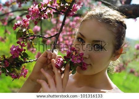 girl beautiful cheerful enjoying over spring Japanese cherry tree - stock photo