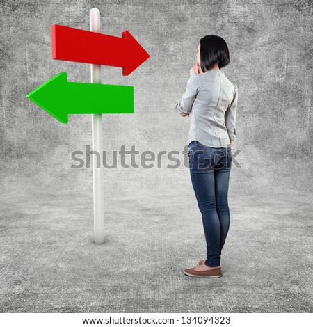 Girl before a white roadsign in fear of the unknown - stock photo