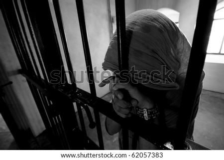 Girl behind bars - stock photo